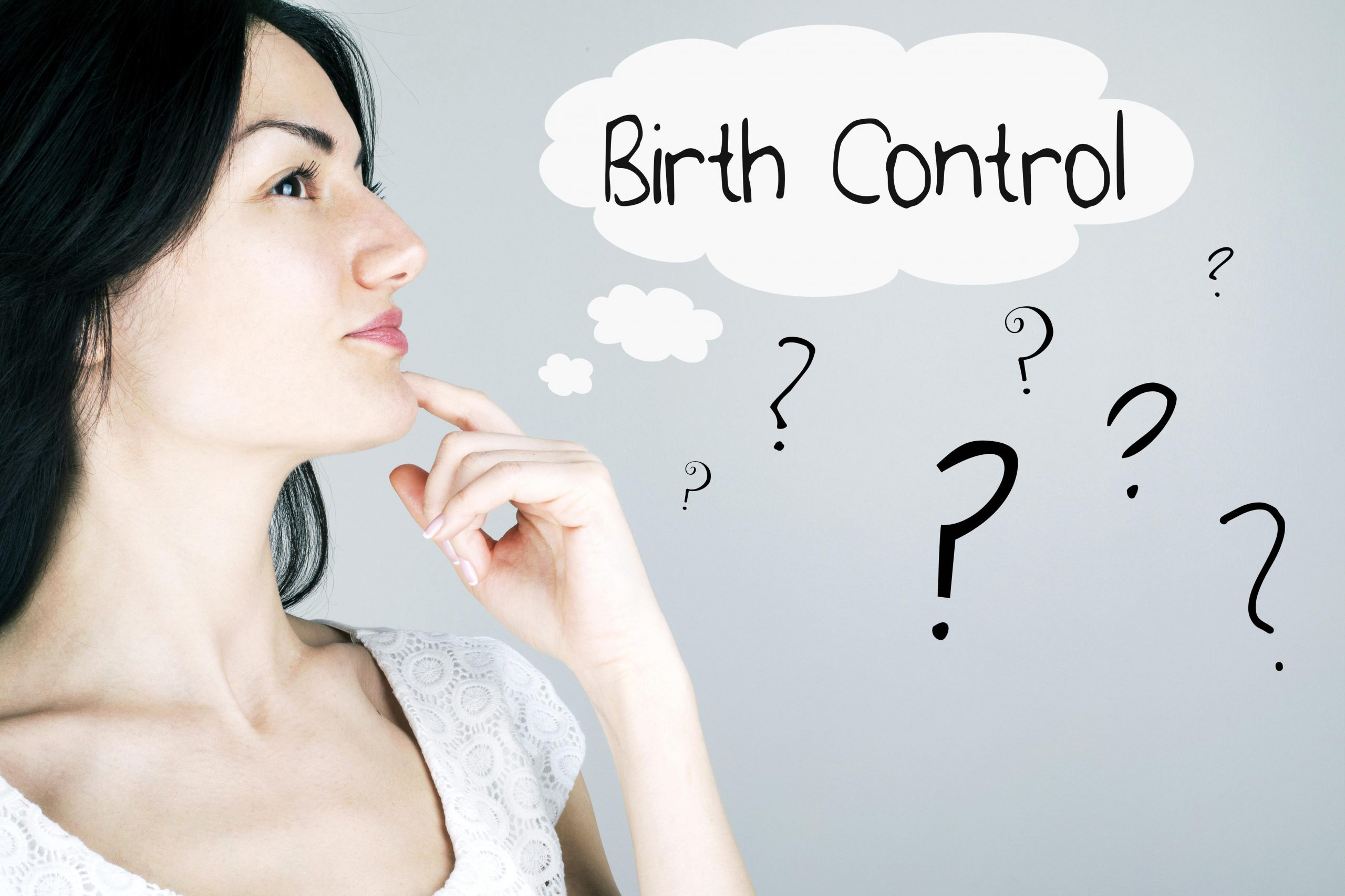 lady with finger on chin thinking about birth control